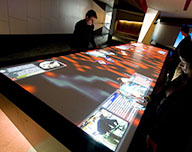 interactive multi-touch table display screen.